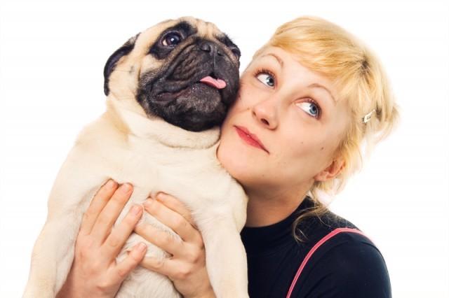owner embracing her pug