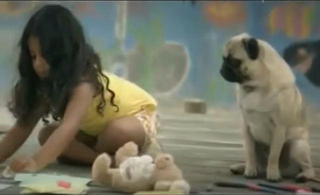 pug watching over little girl