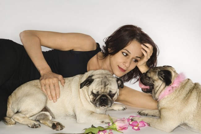 woman with two pugs