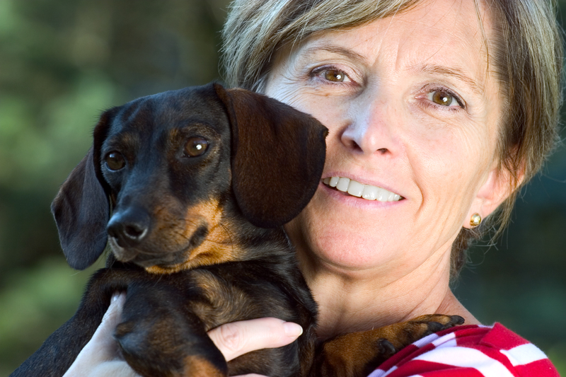 woman holding a doxie